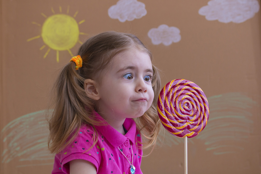 bigstock Funny Child With Candy Lollipo 236050549